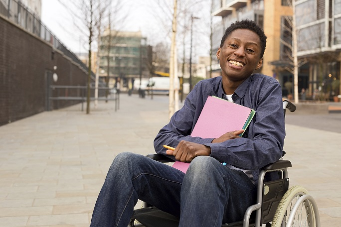 Image of a young man in a wheel chair