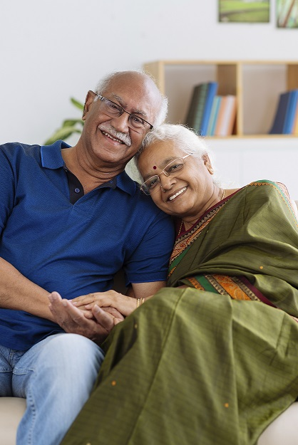 Image of an older couple sitting in a chair together